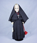 Doll wearing habit worn by Sisters of the Most Precious Blood by Genuine Nun Doll Inc.