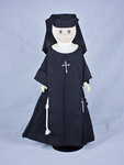 Doll wearing habit worn by Sisters of the Third Order of Saint Francis of Siessen Convent