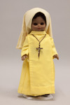 Doll wearing habit worn by Daughters of the Most Blessed Trinity